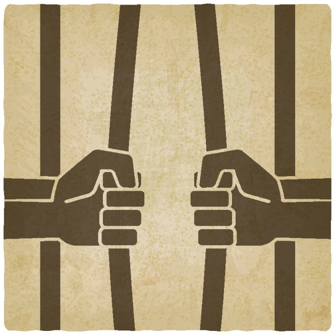 freedom concept. hands breaking prison bars old background