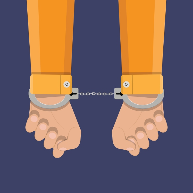human hands in handcuffs